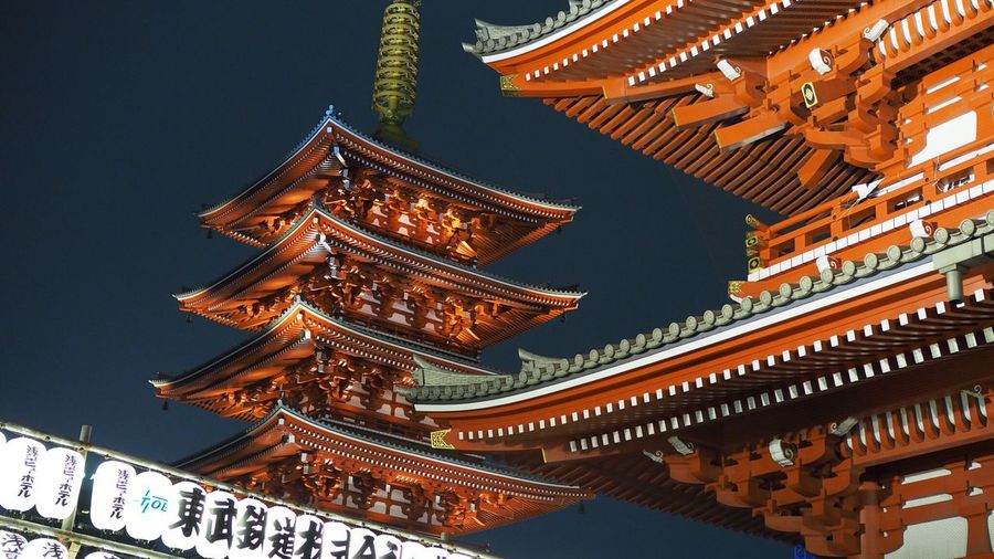 Low angle view of illuminated pagoda against sky
