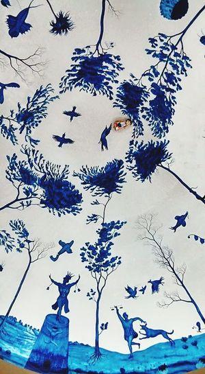 Close-up of birds against blue sky