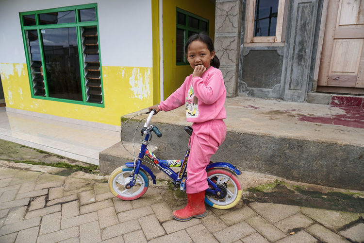 Little village girl. Mount Bromo. Childhood Architecture Females Full Length Child Girls Building Exterior Built Structure Bicycle Women Casual Clothing Smiling Transportation One Person Building Lifestyles Leisure Activity Real People House Outdoors Innocence Bromo Bromo Mountain Bromo-tengger-semeru National Park