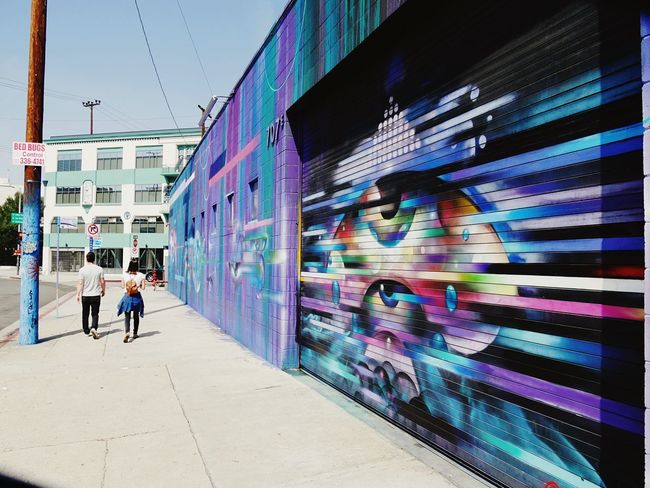 The Wall Couple Art Wall Art Architecture Built Structure Real People Walking Full Length Day California Dreamin Building Exterior Outdoors Multi Colored Sky City People