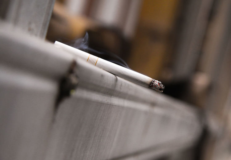 Close-Up Of Cigarette On Railing