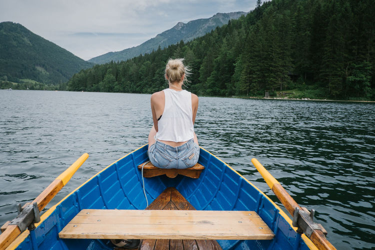 Full length of man on boat in lake
