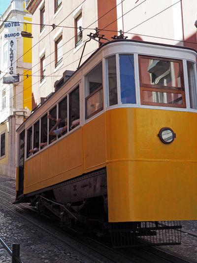 Yellow train in city