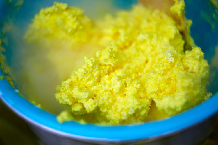 Close-up of yellow soup in bowl