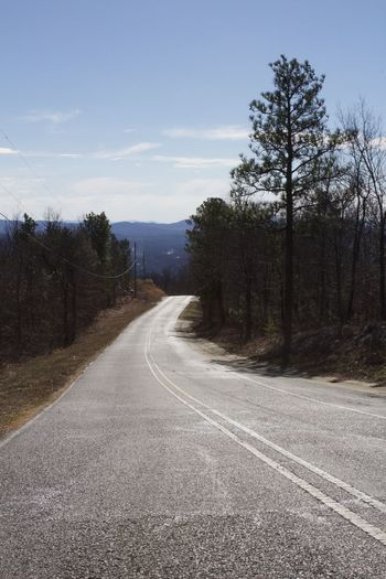 """The Way Down"" / Jacksonville, Alabama Asphalt Beauty In Nature Empty Road Landscape Mountain Natural Gradient Nature No People Outdoors Road Scenics Sky Winding Road"