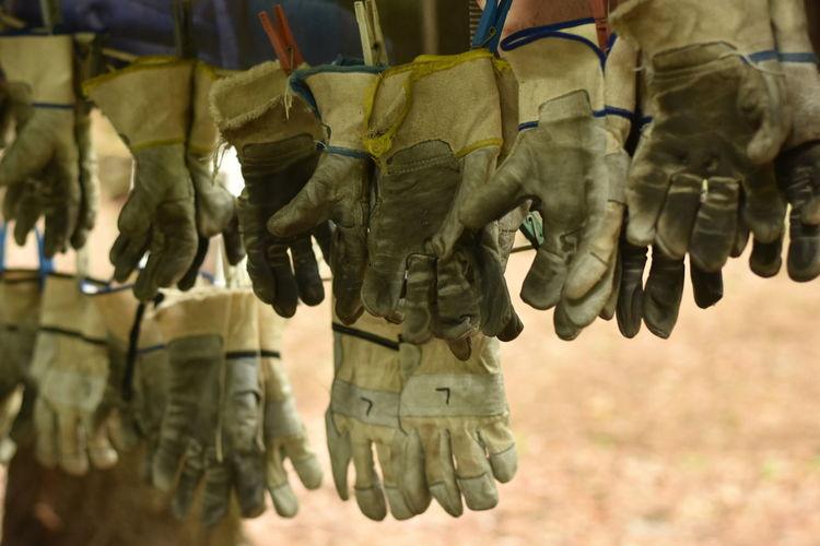 Protective gloves hanging for sale at market
