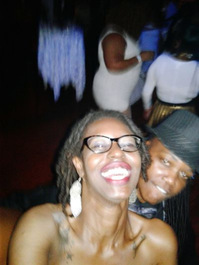 Eyeglasses  Togetherness Smiling Arts Culture And Entertainment Two People Cheerful Happiness Bonding Melanin Smart Phone Awkwardly Awesome Lifestyles Nightlife Lesbian Chocolate Lesbian Pride Beautiful Skin Brown Eyed Girl