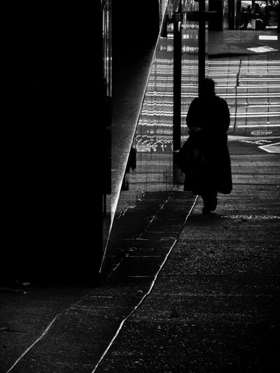 Woman Walking Uphill Sidewalk Granite Building Silhouette Light And Shadow Reflections Black And White Street Photography