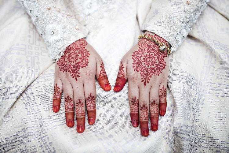 High Angle View Of Bride With Henna Tattoo