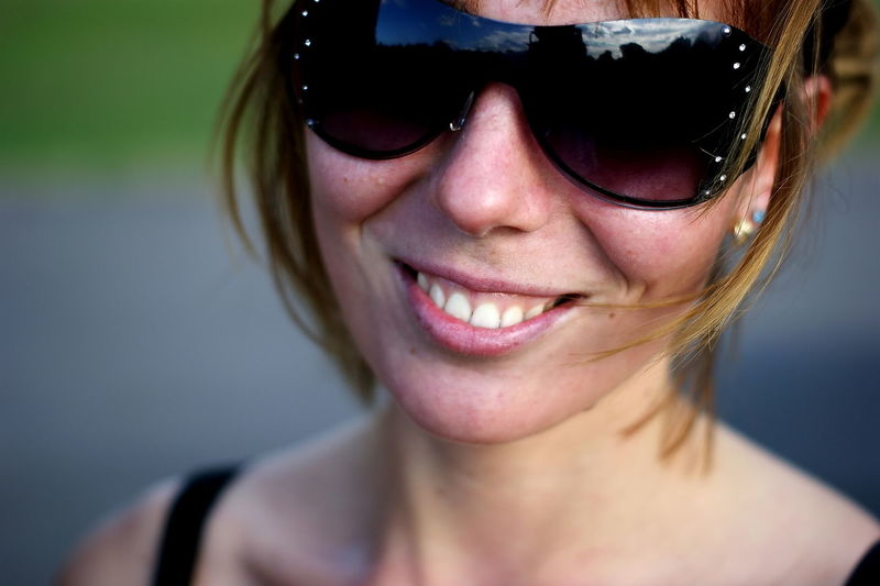 Headshot Portrait Smiling One Person Happiness Teeth Toothy Smile Women Close-up Glasses Emotion Adult Front View Sunglasses Cheerful Focus On Foreground Young Adult Looking At Camera Eyewear Human Face Sashalmi Napszemüveg Smile