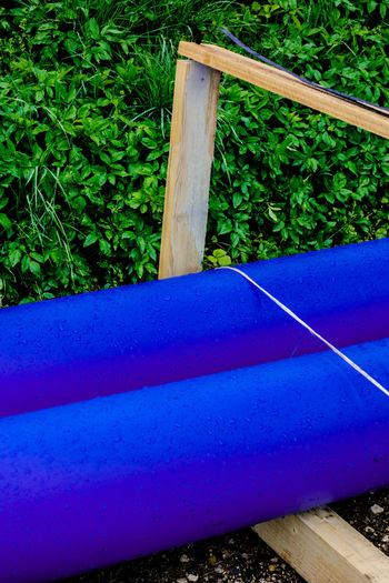 Artifical And Nature Blue Close-up Day Diagonal Grass Material Nature No People Outdoors Plant Plastic And Wood Tie Tree Tube Wood - Material