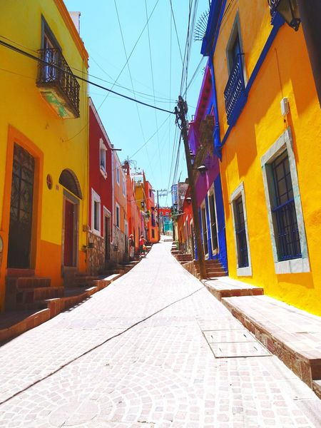 in the colorful alley :) Town Colorful Beautiful Place Tranquility Colorsplash Color Photography Historical Place Full Of Colors Mexicolors Mexico De Mis Amores My favorite place Travel Photography Travelgram Viaje Journeyphotography TOWNSCAPE City Shadow Yellow Architecture Building Exterior Built Structure Double Yellow Line Alley The Way Forward Country Road Narrow Passageway Adventures In The City