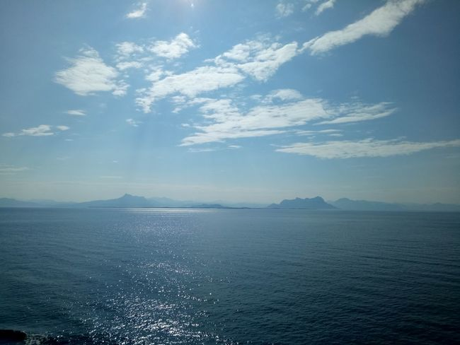 Sea Scenics Outdoors Tranquility Nature Beauty In Nature Water Blue Cloud - Sky Landscape Mountain No People Day Summer Sky Beach Vacations Horizon Over Water Refraction Eyemphotography TheGreatOutdoors Shiplife Point Of View PhonePhotography Planet Earth