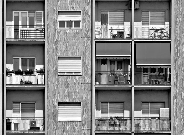 Airconditioning Apartment Buildings Architecture Balcony Blackandwhite Block Of Flats Brickswork Building Exterior Built Structure Bycicle Close-up High Resolution Home Home Decor Lifestyles Lines And Shapes Monochrome No People Pattern Plants Table Black & White Friday Urban Scene Window Shutter Windows