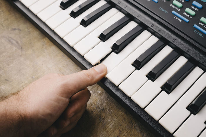 Keyboard synthesizer Black Buttons Close-up Composer Electro Human Body Part Human Finger Indoors  Instrument Key Keyboard Instrument Man Men Music Note Piano Player Playing Real People Song Songwriter Synthesizer Technology White Wood - Material