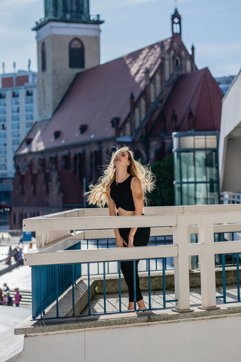 Architecture Beautiful Woman Beauty Blond Hair Building Building Exterior Built Structure City Full Length Hair Hairstyle Leisure Activity Lifestyles Long Hair One Person Outdoors Real People Teenager Young Adult Young Women