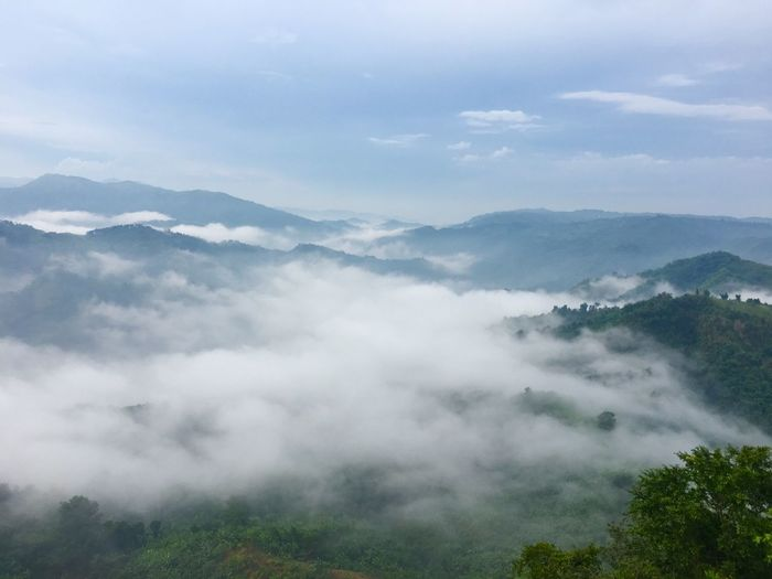 Scenic view of mountains with fog