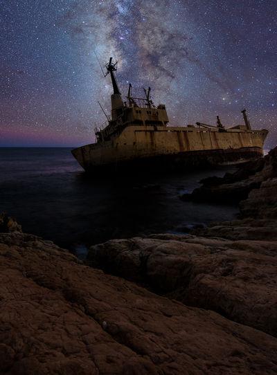 Abandoned Ship On Sea At Night