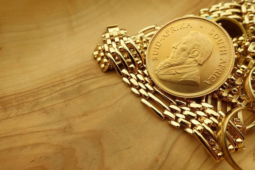 Gold jewelry and coin Close Up Wood Rand Krugerrand Copy Space Nobody Wealth Indoors  Still Life Jewelry Close-up Gold Colored No People Metal Table High Angle View Coin Necklace Luxury Finance Gold Chain