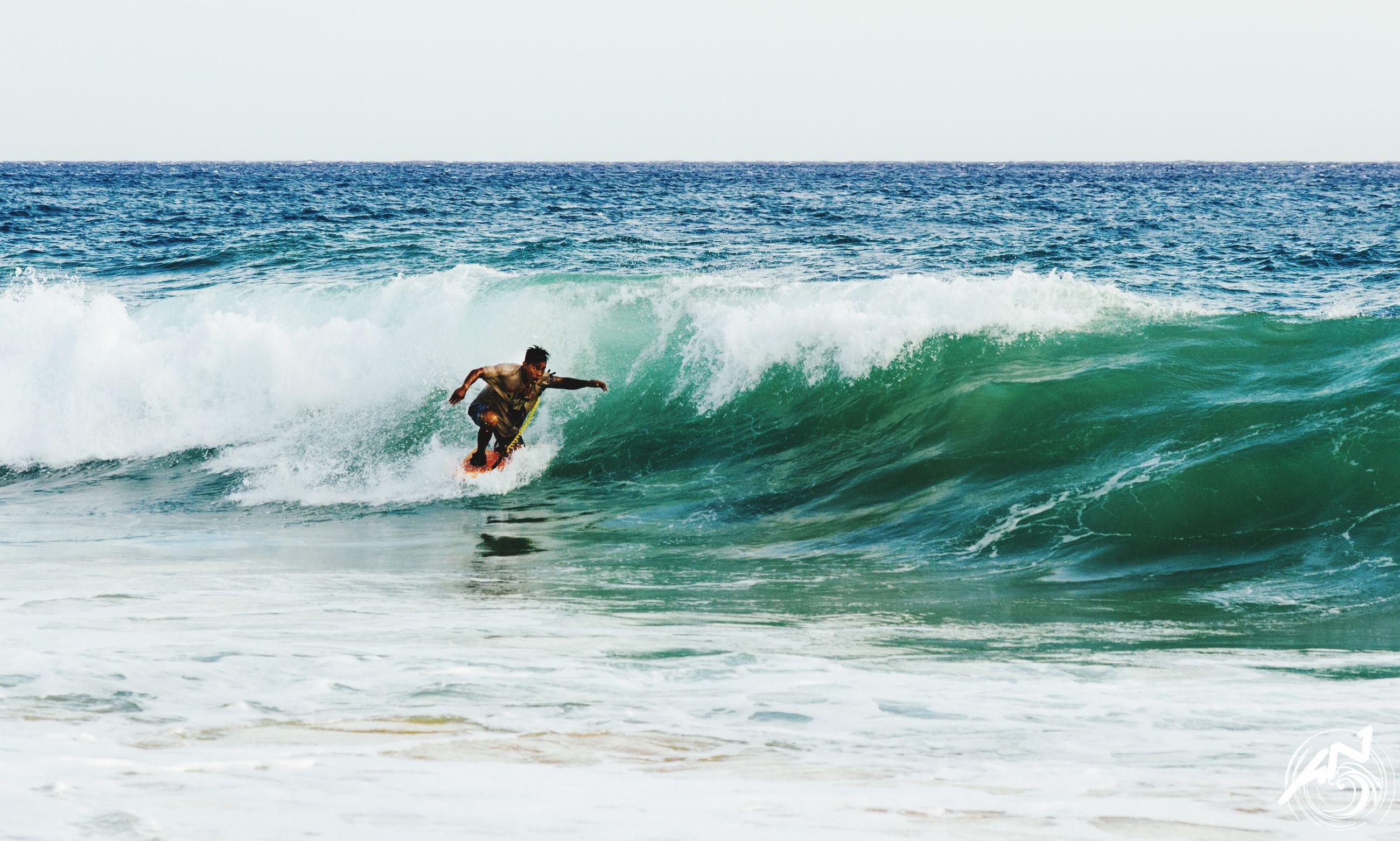 water, sea, leisure activity, lifestyles, wave, horizon over water, motion, men, surfboard, surf, vacations, waterfront, splashing, surfing, enjoyment, full length, water sport, sport