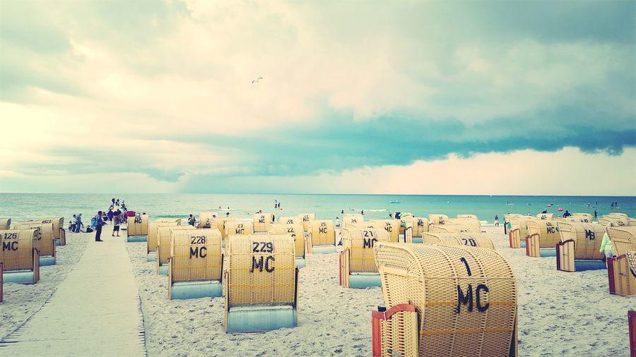 Ostsee Ostseestrand Fehmarn Fehmarnsundbrücke Nordsee Norden Strandkorb Water Sea Beach Sand Sky Horizon Over Water Cloud - Sky Beach Holiday