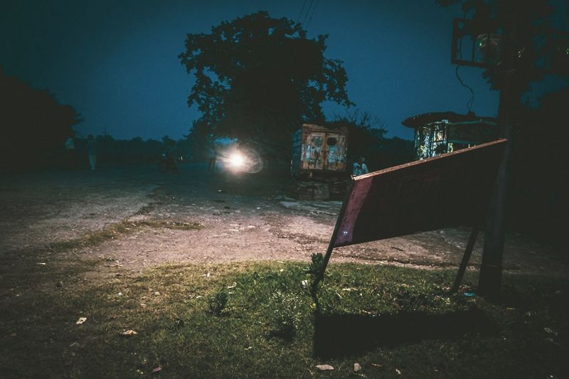 Old Light Light Source Street Light Sign Board Landscape Noperson Light People Travel Evening Vehicle Dusk Vintage Dark Mood Tree Soccer Field Illuminated Sport Playground Sky Grass Outdoor Play Equipment Playing Field Urban Scene Blurred Hanging Light Countryside Fairy Lights