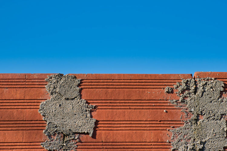 The Bricks Built Structure Architecture Wall - Building Feature Day No People Brown Building Exterior Outdoors Old Brick Brick Wall Bricks Sky Blue Clear Sky Copy Space Wall Low Angle View Sunlight EyeEm Selects EyeEm Best Shots EyeEm Gallery