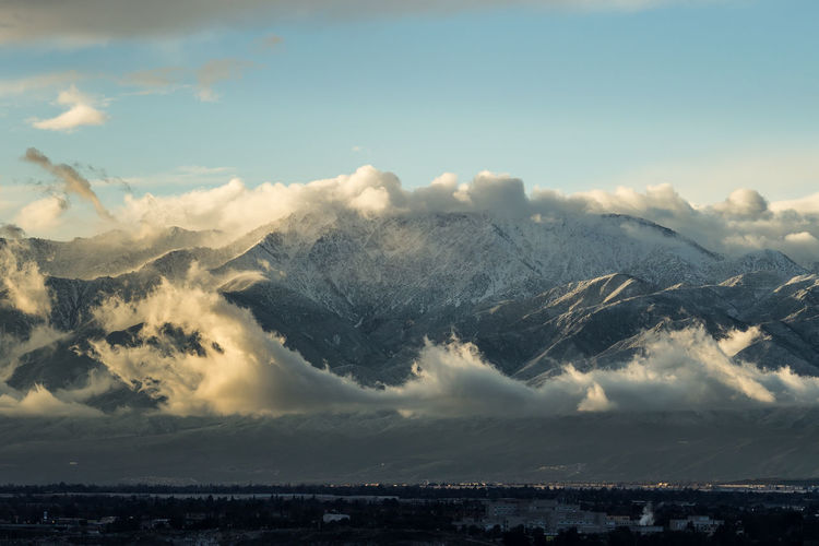 Mount Baldy / Mount San Antonio with snow and moody clouds Cloud - Sky Sky Beauty In Nature Scenics - Nature Tranquil Scene Tranquility Mountain Nature No People Mountain Range Environment Outdoors Non-urban Scene Landscape Day Snowcapped Mountain Snow Moody Sunset Evening