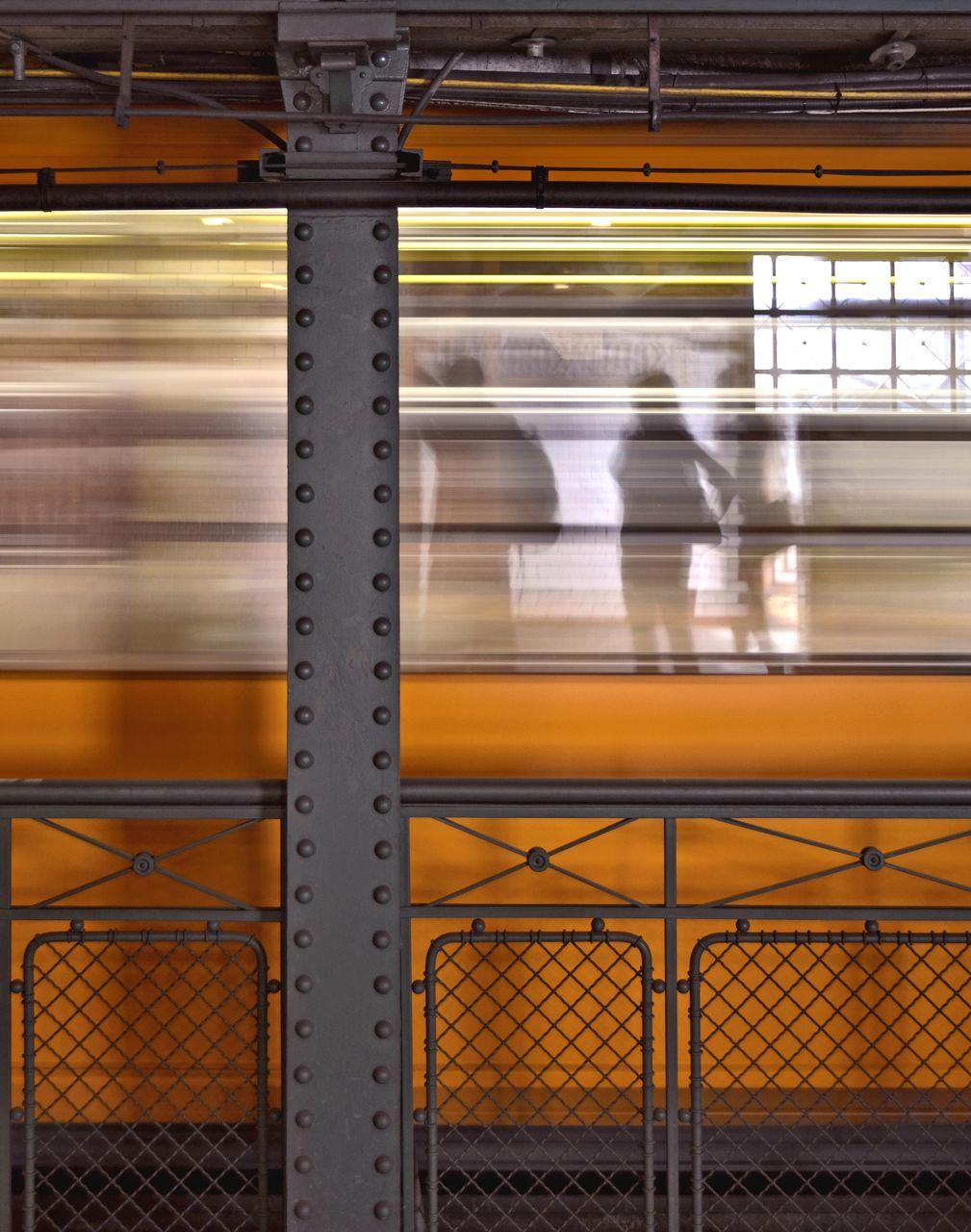TRAIN AT SUBWAY STATION PLATFORM