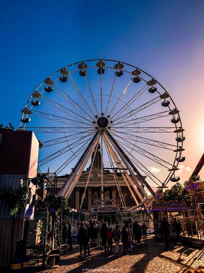 View of ferris wheel against clear blue sky