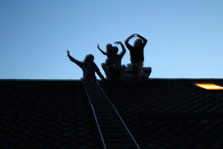 children in the dark Munich, Germany Adult Arms Raised Blue Clear Sky Copy Space Day First Eyeem Photo Full Length Group Of People Human Arm Leisure Activity Lifestyles Limb Low Angle View Men Nature People Real People Roof Sky Women