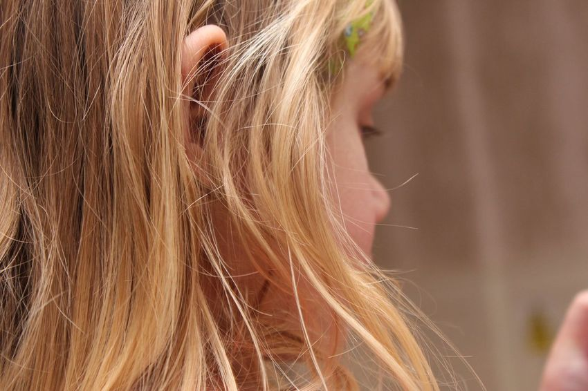 EyeEm Selects Blond Hair Real People Focus On Foreground One Person Childhood Long Hair Human Hair Girls Lifestyles Close-up Outdoors Day People