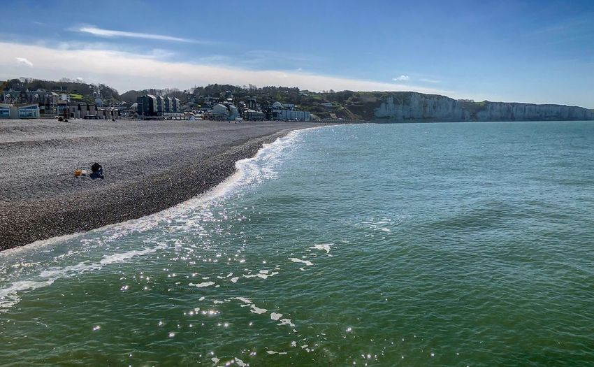 Blue sea, white cliffs and pebble beach of Fécamp, Normandy,France under a clear blue sky Water Sky Scenics - Nature Nature Sea Beauty In Nature Day No People Tranquil Scene Motion Tranquility Land Outdoors Beach Blue Plant Waterfront Idyllic Non-urban Scene Breaking