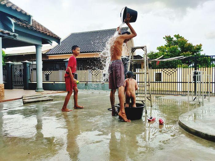 People bathing outdoors