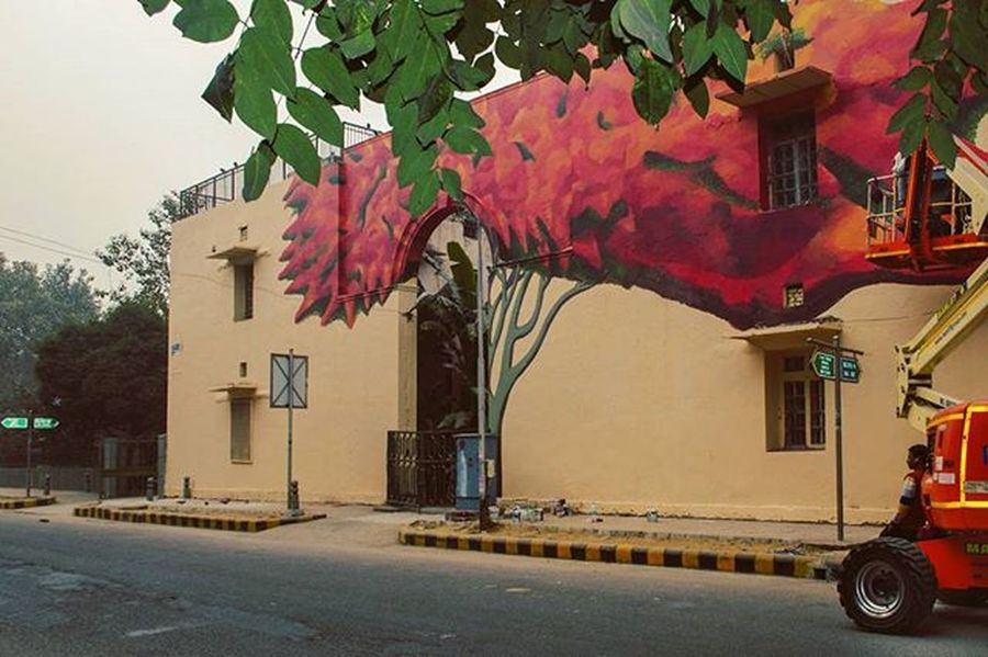 "A great art work done by Anpu Varkey, i suggest you all to see her work by visiting lodhi art district in lodhi colony, Delhi. As she making a tree on the wall, i am relating it with the real tree leafs up above in the picture and you can also see her working with the crane in the right side of the picture...she told us that she is doing this for the ""st+art india foundation"" as well as for the international street art festival. Startindiafoundation Sodelhi Dfordelhi _soi Worldwide India Incredibleindia Startindia Startdelhi Mural Streetart Streetartindia Streetartdelhi UrbanART Lodhiartdistrict Worldwide Yehdelhihai Dilli Instagram Photojournalism Streetartofindia Internationalstreetartfestival Lodhicolony Everydayeverywhere DelhiLove cleanindia greenindia tree globalindia storytelling start"