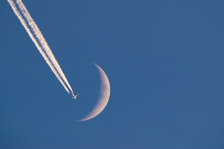 Plane passing by the moon Aero Aerospace Airplane Astro Astronomy Blue Crescent Flight Flying Jet Luna Moon Moon Nature Passing Sky Transportation Travel Traveling