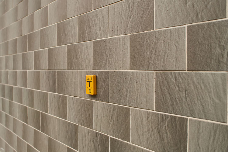 Architecture Bathroom Built Structure Close-up Day Indoors  No People Tile Wall Wall Art Wall Lines Yellow Streetphotography Street Photography Street Art Grey Color Grey Wall Textures