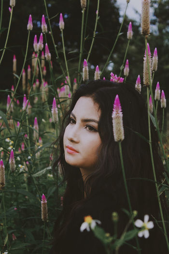 Close-up of young woman with flowers
