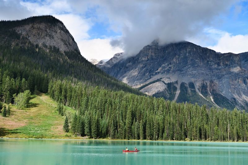 Kayak canoe on Emerald lake canada Mountain Scenics Beauty In Nature Emerald Lake,canada Tranquil Scene Tranquility Water Lake Nature Sky Tree Mountain Range Reflection Waterfront Non-urban Scene Outdoors Day Forest Landscape Nautical Vessel No People