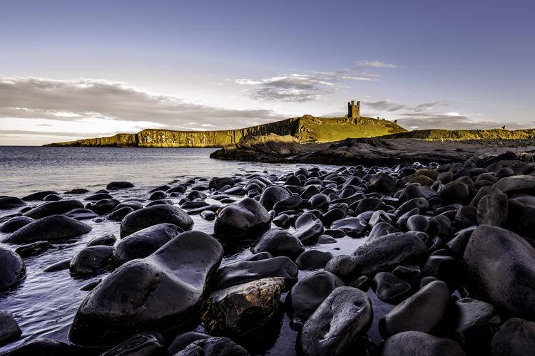 Sunlit castle on the coast
