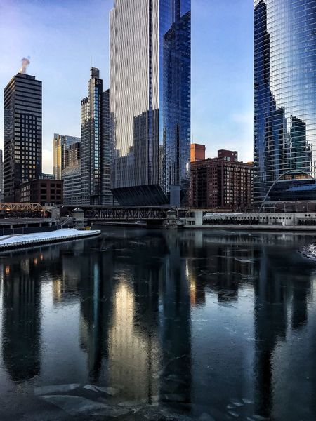 Frozen Chicago River reflection cityscape on snowy December morning Ice Elevated Track Chicago El Chicago Loop Reflection Bridge - Man Made Structure Riverwalk Chicago River Chicago Chicago Architecture Architecture Skyscraper Building Exterior Reflection Built Structure City Modern Waterfront Water Urban Skyline Cityscape Tower River Sky Outdoors City Life Travel Destinations Downtown District Day No People Shades Of Winter