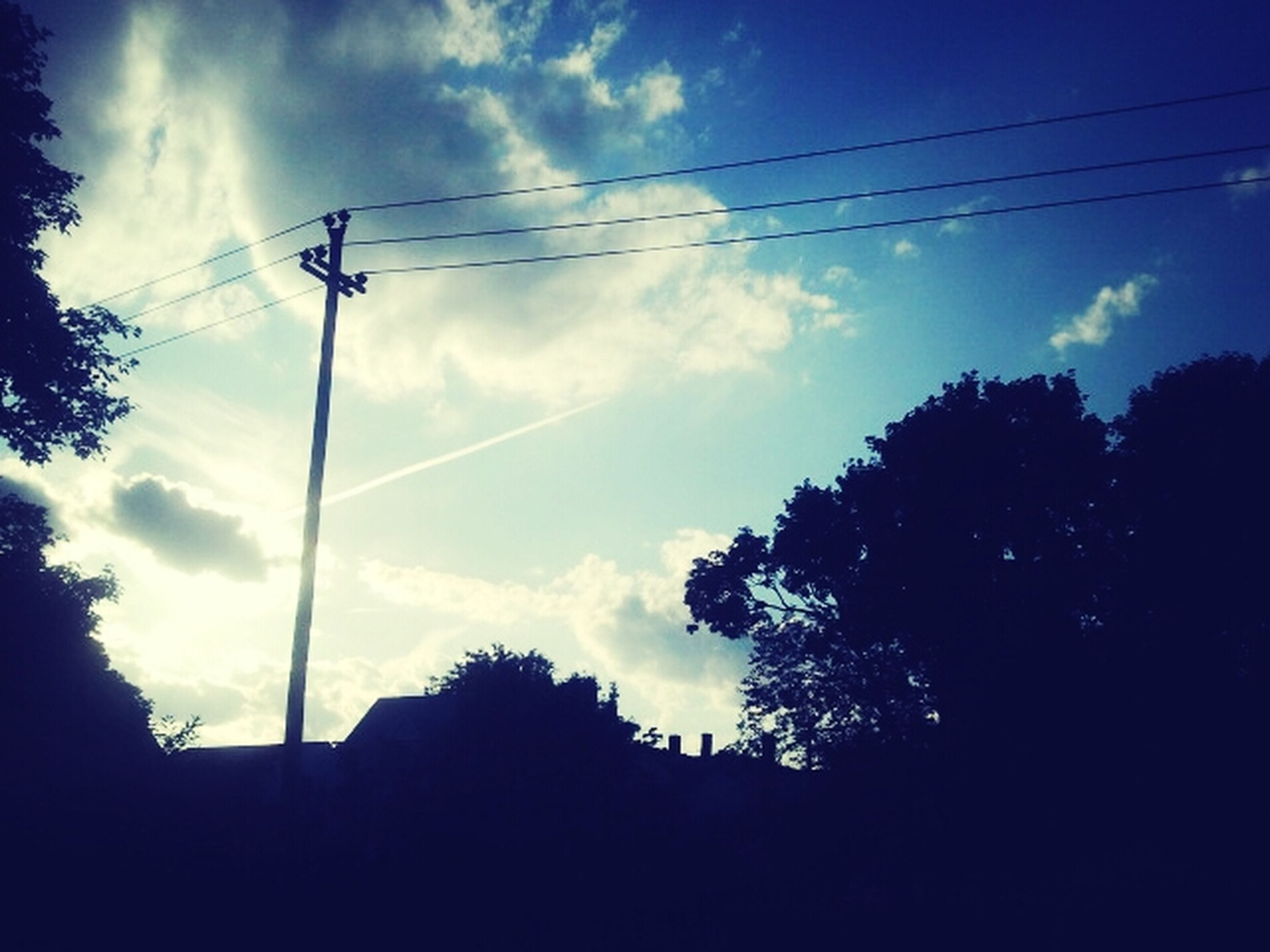 power line, electricity pylon, low angle view, cable, electricity, sky, power supply, silhouette, tree, connection, power cable, cloud - sky, fuel and power generation, cloud, technology, street light, cloudy, nature, dusk, outdoors