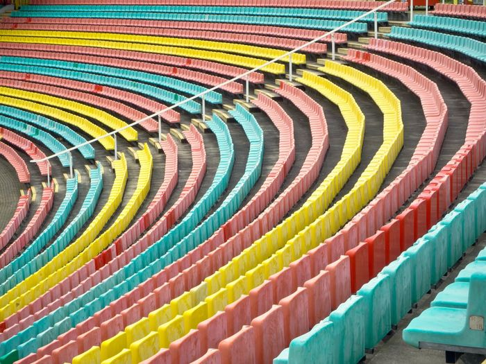 Full frame shot of colorful chairs in stadium