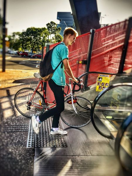 Bicycle Full Length Transportation One Person Mode Of Transport Casual Clothing Young Adult City Land Vehicle Outdoors Day EyeEm Best Shots City Life VSCO Cycling One Man Only Adults Only People Only Men Adult Sky Train Streetphotography Real People MelbournePhotographer