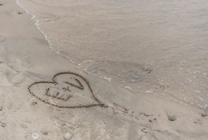 Love notes on the beach Love Beach Sand Land High Angle View No People Nature Tranquility Water Sea Heart Shape Drawing - Art Product Art And Craft Pattern Beauty In Nature Tranquil Scene Creativity Day