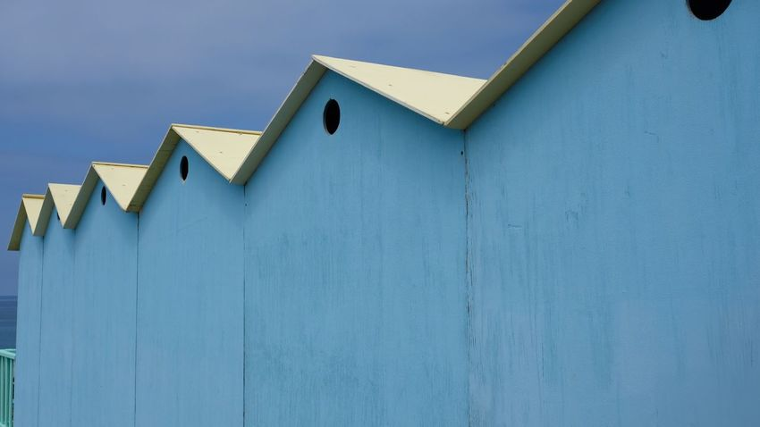 Cabin Blue Built Structure Building Exterior Architecture No People Low Angle View Day Sky Wood - Material Building Clear Sky Wall Copy Space Roof Wall - Building Feature Outdoors Beach Hut House