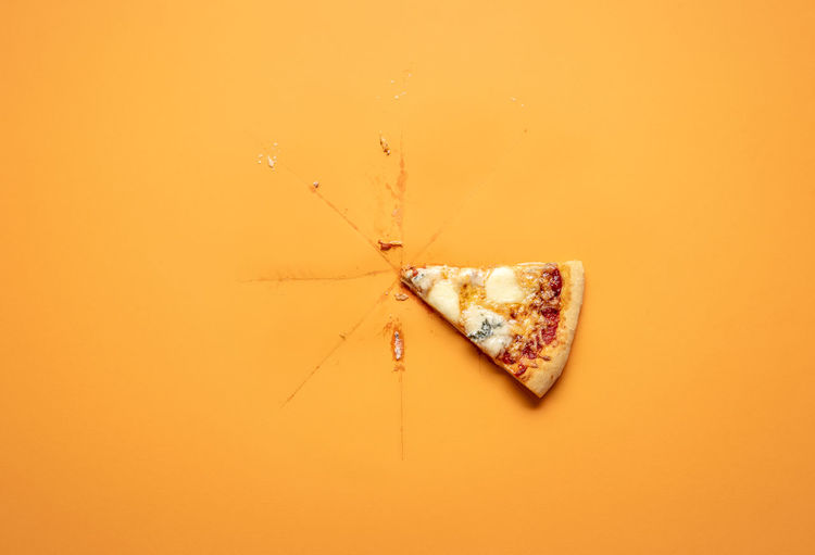 Directly above shot of heart shape against orange background