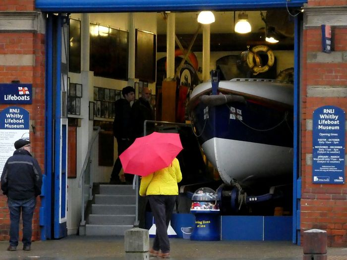 Waiting Game Adults Only Lifeboat Museum Steps Eyemschool Boat Signs Real People People And Places Boathouse Women Red Umbrella Yellow Jacket Rainy Season Charitywork Eyemschool