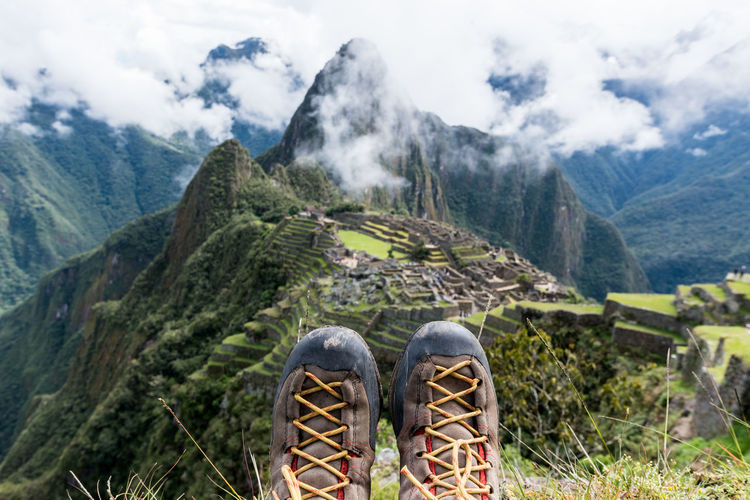 Low section of man against machu picchu
