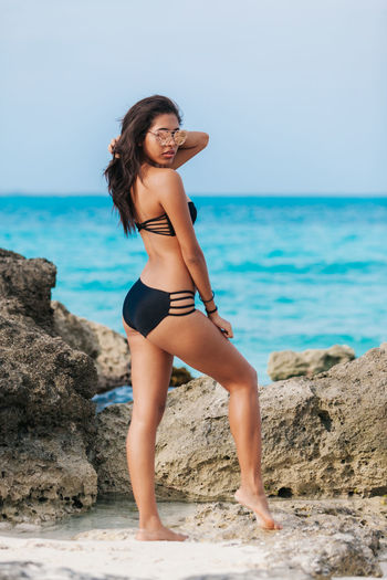 Girl at the beach posing for the camera Beach Beach Life Beautiful People Beautiful Woman Beauty Cheerful Fashion Females Full Length Happiness Human Body Part Lifestyle Lifestyles Looking At Camera People Portrait Relaxation Sea Smiling Standing Summer Travel Travel Destinations Vacations Women
